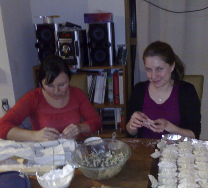 Rebecca and Caroline pleating dumplings