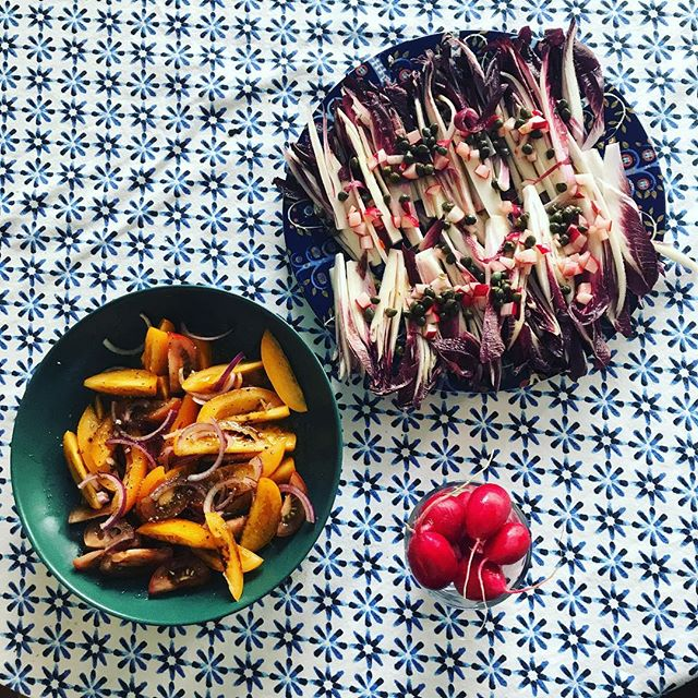 Red endive salad and yellow tomato salad